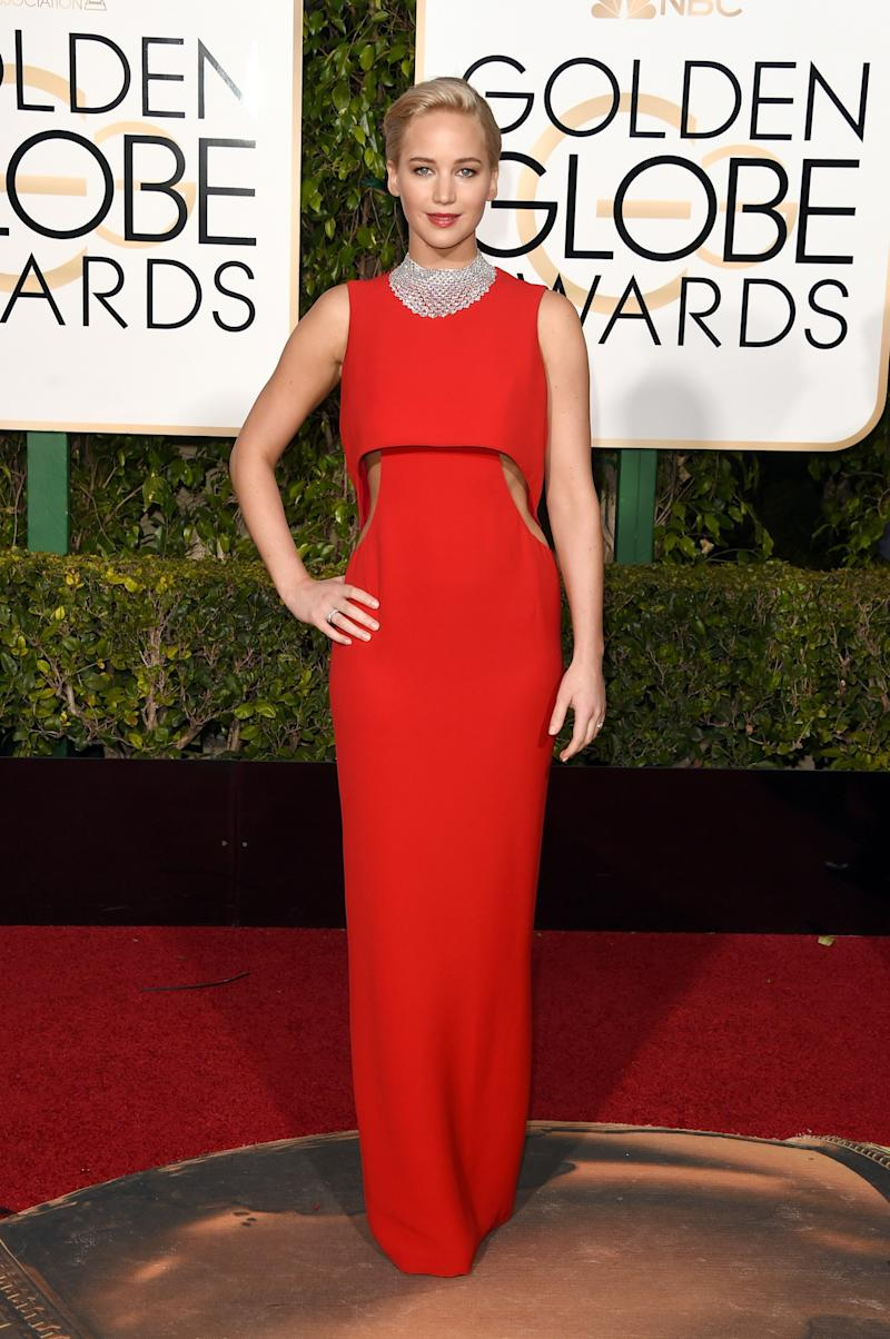 The actress emitted classic Hollywood glamour in a red formfitting Dior gown paired with Chopard jewelry at the 73rd Annual Gold Globes in Beverly Hills, California.