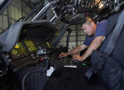 Avionics mechanic Mike Luong inspects the control panel of Sikorsky Firehawk helicopter at the California Department of Forestry and Fire Protection's Sacramento Aviation Management Unit based at McClellan Airpark in Sacramento, Calif., Friday, July 23, 2021. Firefighters are trying to become smarter in how they prepare for the drought- and wind-driven wildfires that have become more dangerous across the American West in recent years, including by adding aircraft like the Sikorsky Firehawk helicopters or military surplus C-130 transport aircraft retrofitted to drop fire retardant. (AP Photo/Rich Pedroncelli)