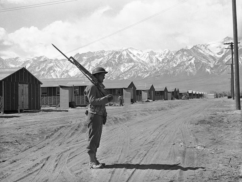 An American soldier guards a Japanese internment camp at Manzanar, Calif., May 23, 1943. (AP Photo)