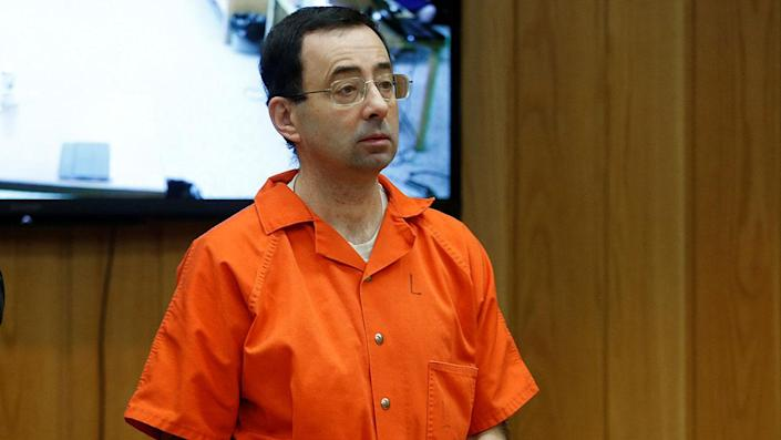 """Larry Nassar, a former team USA Gymnastics doctor who pleaded guilty in November 2017 to sexual assault charges, stands in court during his sentencing hearing in the Eaton County Court in Charlotte, Michigan, U.S., February 5, 2018. REUTERS/Rebecca Cook <span class=""""copyright"""">Reuters</span>"""