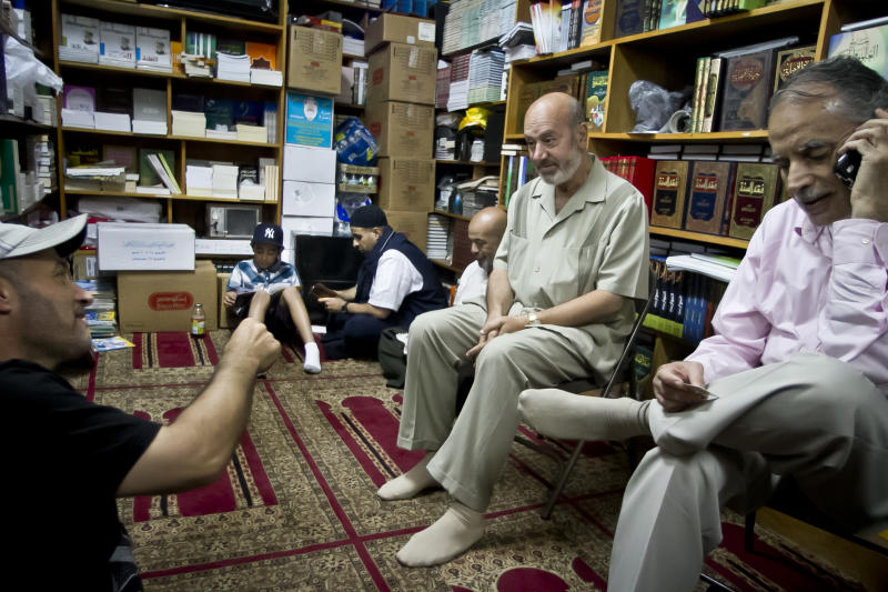 Zein Rimawi, 59, second from right, a leader and founder of the Islamic Society of Bay Ridge and mosque, meet with members in his office before a Jumu'ah prayer service at the mosque on Friday, Aug. 16, 2013 in Brooklyn, N.Y. The NYPD targeted his mosque as a part of a terrorism enterprise investigation beginning in 2003, spying on it for years. The mosque has never been charged as part of a terrorism conspiracy. (AP Photo/Bebeto Matthews)