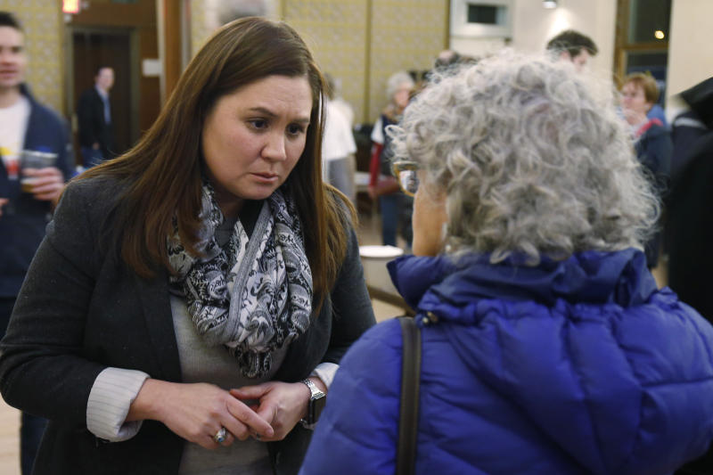 FILE—In this file photo from Feb. 18, 2020, Nikki Foster, Democratic candidate for Ohio's first congressional district, greets a woman following a question and answer session held by the Bold New Democracy Work Group, in Cincinnati. In Ohio, candidates such as Democratic congressional hopefuls Foster and Kate Schroder nearly emptied their campaign coffers in the closing days before March 17, and now are focusing on social media and phone banks to keep up their campaigns while awaiting clarity on when the primary will end amid the coronavirus stay-home orders. (AP Photo/Gary Landers, File)
