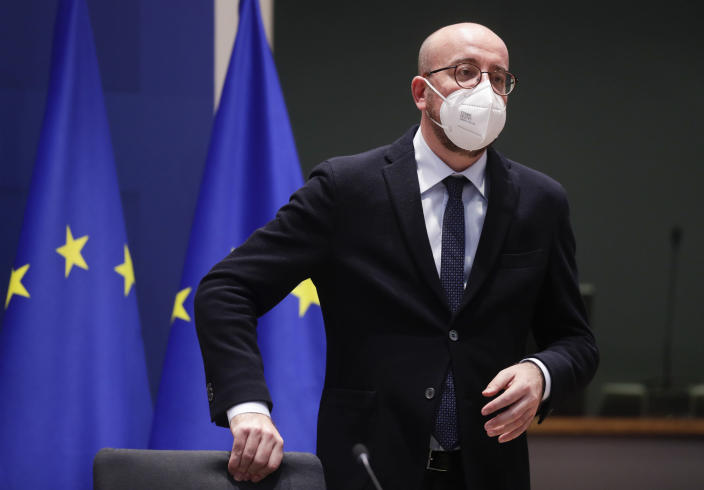European Council President Charles Michel prepares to take part in an EU Summit, via videoconference link, at the European Council building in Brussels, Thursday, Feb. 25, 2021. European Union leaders are gathering Thursday, via videoconference link, to try to inject new energy into the 27-nation bloc's lagging coronavirus vaccination effort as concern mounts that new variants might spread faster than authorities can adapt. (Olivier Hoslet, Pool via AP)
