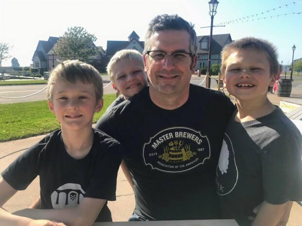 Josh Mayich with his three sons. (Submitted by Josh Mayich - image credit)