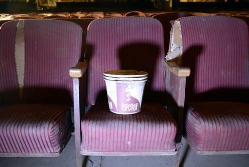 """<span class=""""caption"""">The decision by Warner fuels a popular fallacy that studios simply react to what customers want.</span> <span class=""""attribution""""><a class=""""link rapid-noclick-resp"""" href=""""https://www.shutterstock.com/image-photo/seat-vintage-popcorn-bucket-abandoned-movie-1138616186"""" rel=""""nofollow noopener"""" target=""""_blank"""" data-ylk=""""slk:Cory Seamer/Shutterstock"""">Cory Seamer/Shutterstock</a></span>"""