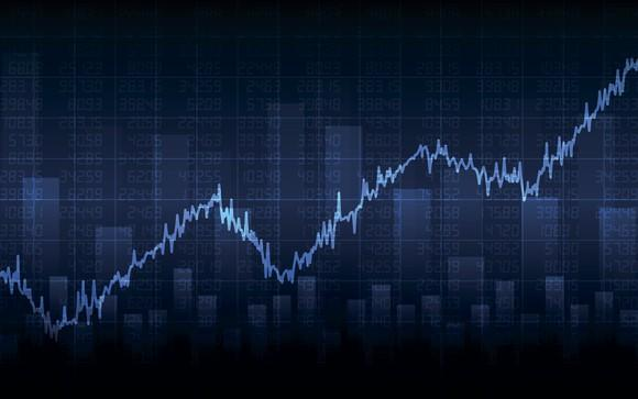 Stock market chart with dark blue background indicating gains