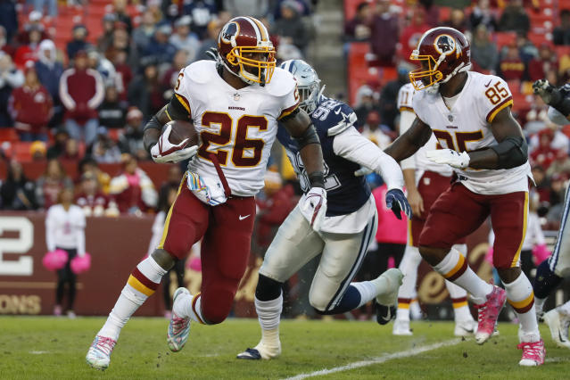 Washington Redskins running back Adrian Peterson (Q) was named NFC offensive player of the week. (AP)