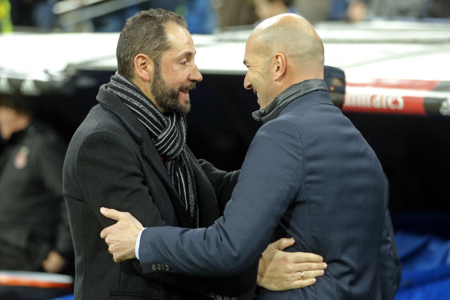 Girona's coach Pablo Machin, left and Real Madrid's head coach Zinedine Zidane greet each other before the start of a Spanish La Liga soccer match between Real Madrid and Girona at the Santiago Bernabeu stadium in Madrid, Spain, Sunday, March 18, 2018. (AP Photo/Paul White)
