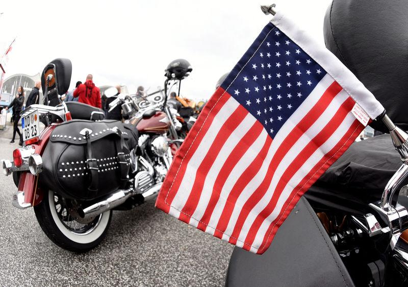 """FILE PHOTO: A U.S. flag is pictured in front of Harley-Davidson bikes at the """"Hamburg Harley Days"""" in Hamburg"""