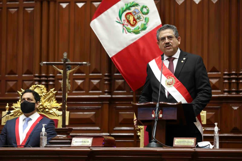 FILE PHOTO: Peru's interim President Manuel Merino addresses lawmakers at Congress after he was sworn in following the removal of President Martin Vizcarra, in Lima