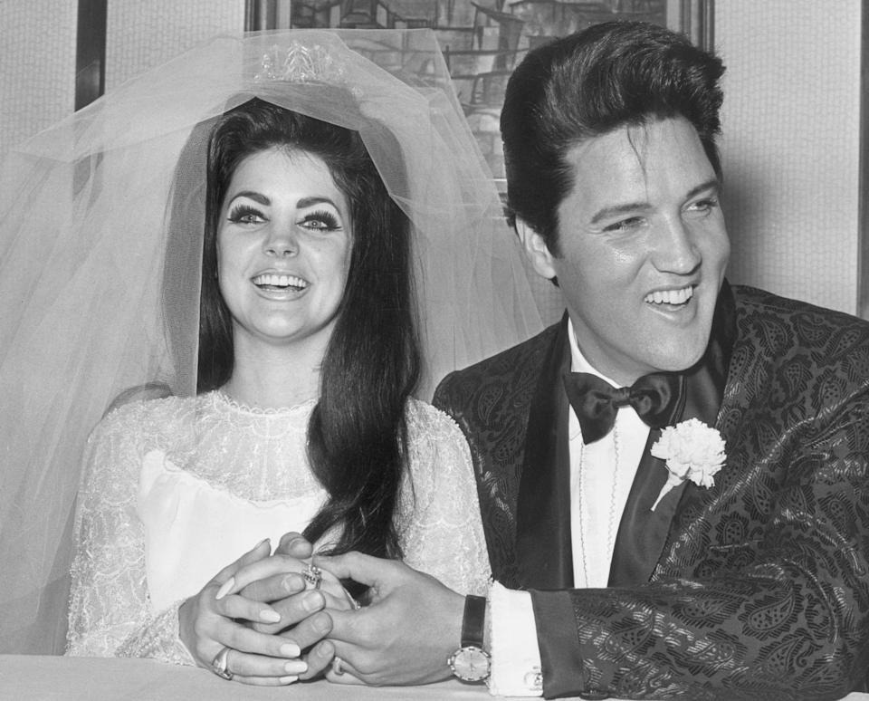 1st May 1967:  Rock and roll singer and actor Elvis Presley (1935 - 1977) holding hands with his bride, Priscilla Beaulieu Presley, on their wedding day, Las Vegas, Nevada.  (Photo by Hulton Archive/Getty Images)