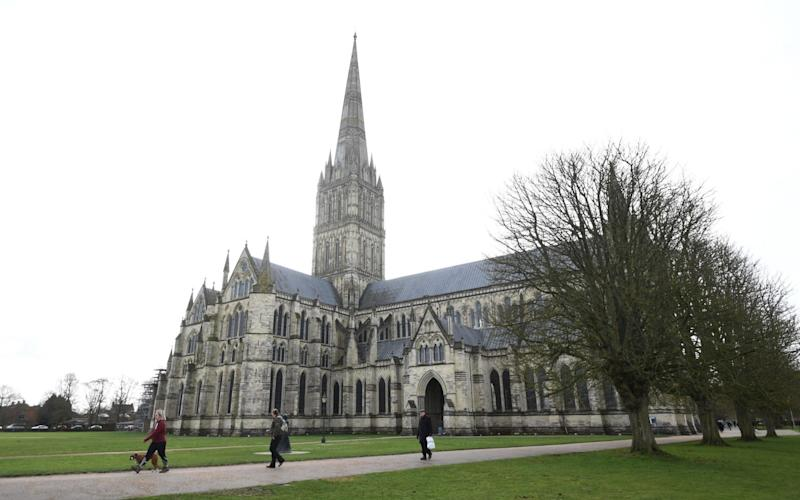 Heated cushions could soon be used to keep congregations warm in draughty, ancient churches such as Salisbury Cathedral to help the CoE meet its new a zero emissions target by 2045 - EPA