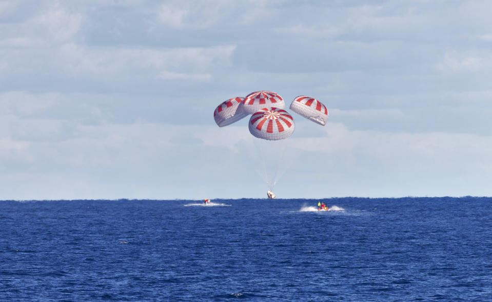 SpaceX's Crew Dragon is guided by four parachutes as it splashes down in the Atlantic Ocean about 200 miles off Florida's east coast on March 8, 2019, after returning from the International Space Station on the Demo-1 mission. The uncrewed spacecraft docked to the orbiting laboratory on March 3, following a 2:49 a.m. EST liftoff aboard a SpaceX Falcon 9 rocket from Launch Complex 39A at NASA's Kennedy Space Center in Florida on March 2. Crew Dragon made 18 orbits of Earth before successfully attaching to the space station. The spacecraft undocked at 2:32 a.m., March 8, splashing down in the Atlantic Ocean at 8:45 a.m. SpaceX's inaugural flight with NASA's Commercial Crew Program is the first flight test of a space system designed for humans built and operated by a commercial company through a public-private partnership. NASA and SpaceX will use data from Demo-1 to further prepare for Demo-2, the crewed flight test that will carry NASA astronauts Bob Behnken and Doug Hurley to the International Space Station later this year.