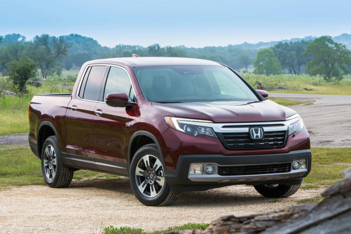 This undated photo provided by Honda shows the Honda Ridgeline, a midsize truck that's one of Edmunds' favorites in the class. While it may not have the off-road capability that some of its competitors do, it's still an excellent choice for camping thanks to all sorts of smart available options and dealer accessories such as a bed-mounted tent. (American Honda Motor Co. via AP)