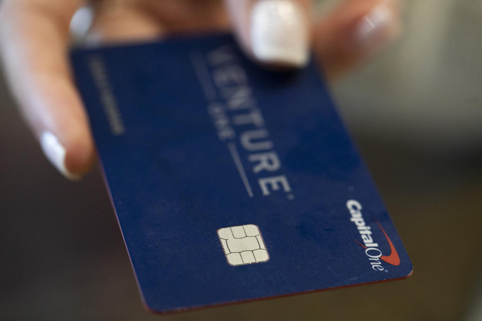 This Sunday, Aug. 11, 2019, photo shows a Capital One credit card in New Orleans. (AP Photo/Jenny Kane)