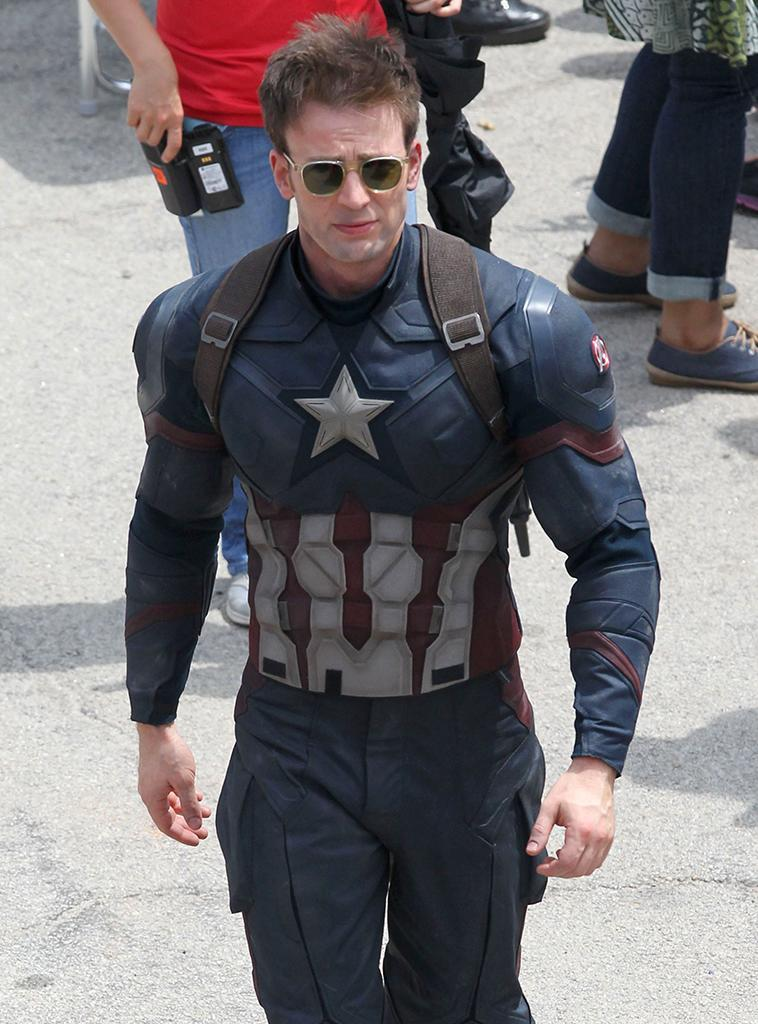 We're guessing those glasses aren't part of Cap's regulation uniform, but this is the first look at Evans in costume on set in Atlanta on May 15. The outdoor scene attracted photographers and fans.