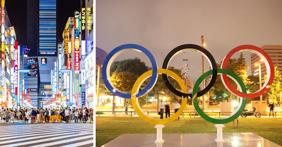A busy street in the Toyko district of Shinjuku at night and the Olympic rings.