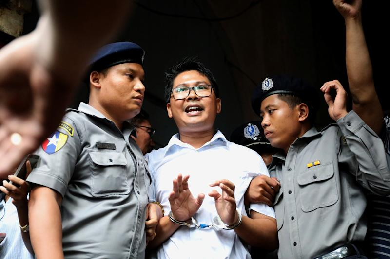 Myanmar court jails Reuters reporters for 7 years in landmark secrets case