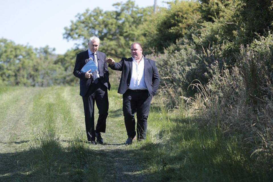 Former chief constable Jon Boutcher (left), with Eugene Oliver, as they make a fresh appeal for information relating to the murder of his father, Tom Oliver (Arthur Carron/PA) (PA Wire)