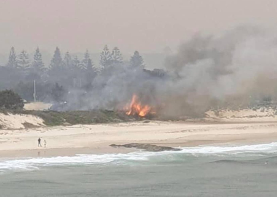 A fire shown burning at Forster's main beach in NSW.