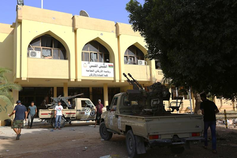 Members of the Islamist-linked militia of Misrata are seen stationed outside an army headquarter's building following three days of battles in the area of Tripoli's International airport, on August 21, 2014 (AFP Photo/Mahmud Turkia)