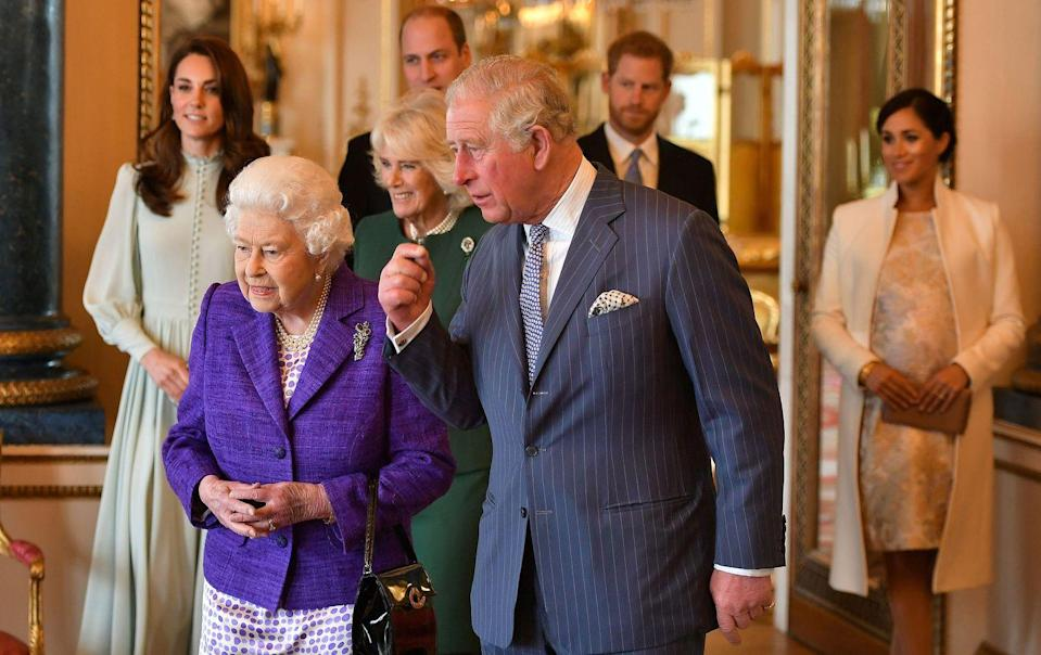"""<p>This year marks the 50th anniversary of Prince Charles's investiture as the Prince of Wales. Here he is with his family looking at the insignia, which Charles was presented with in 1969. <strong><a href=""""https://www.townandcountrymag.com/society/tradition/g26594811/prince-charles-of-wales-investiture-anniversary-royal-family-photos/"""" rel=""""nofollow noopener"""" target=""""_blank"""" data-ylk=""""slk:See more photos from the party here."""" class=""""link rapid-noclick-resp"""">See more photos from the party here.</a></strong></p>"""