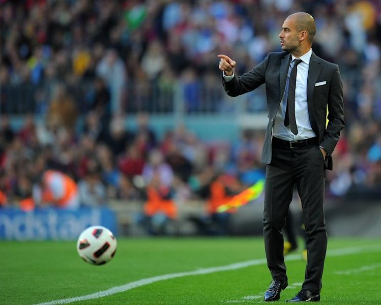 A photo taken on April 23, 2011 shows then-Barcelona coach Pep Guardiola during a league match at the Camp Nou. German giants Bayern Munich won the battle to secure the most sought after coach in football when Guardiola agreed to take over as head coach for the 2013/14 season