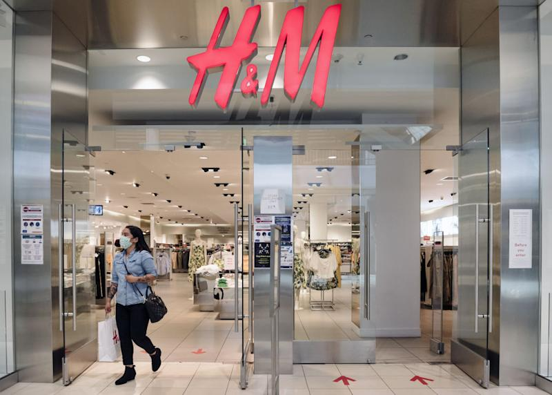 A shopper wearing a protective mask walks out of a Hennes & Mauritz (H&M) clothing store at Westfield San Francisco Centre in San Francisco, California, U.S., on Thursday, June 18, 2020. San Francisco moved into Phase 2B on Monday, opening up outdoor dining and allowing customers to go inside retail stores to shop. Photographer: Michael Short/Bloomberg