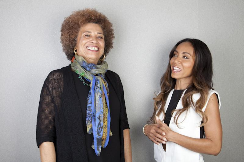 """This April 4, 2013 photo shows author and activist Angela Davis, left, and actress-filmmaker Jada Pinkett Smith posing for a portrait to promote the documentary, """"Free Angela and All Political Prisoners,"""" in New York. (Photo by Amy Sussman/Invision/AP)"""