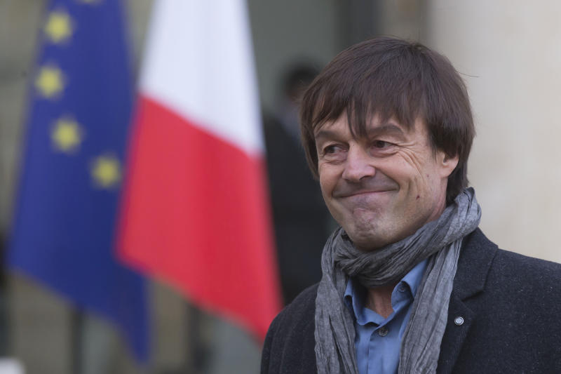 FILE - In this Thursday, Dec. 6, 2012 file photo, environmental activist Nicolas Hulot, smiles as he leaves the Elysee Palace in Paris, France. France's high-profile environment minister, former TV personality Nicolas Hulot, has unexpectedly announced his resignation live on national radio, dealing a blow to the lofty green ambitions of President Emmanuel Macron. (AP Photo/Michel Euler, File)