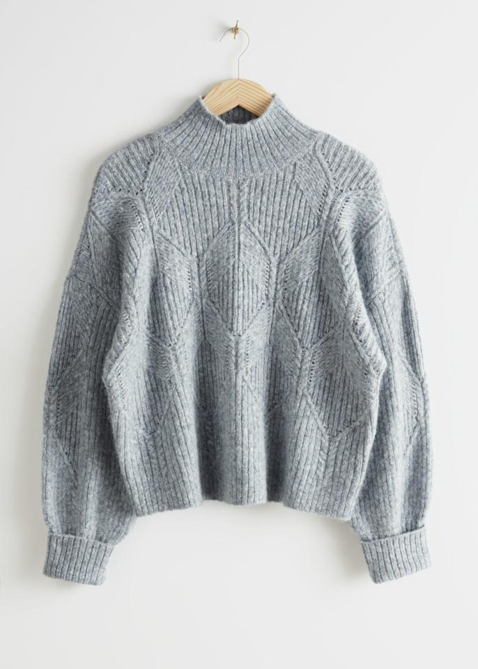 """$99, & Other Stories. <a href=""""https://www.stories.com/en_usd/clothing/knitwear/sweaters/product.boxy-cable-knit-sweater-blue.0777980002.html"""">Get it now!</a>"""