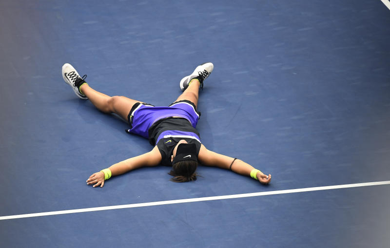 Bianca Andreescu, of Canada, lays on the court after defeating Serena Williams, of the United States, during the women's singles final of the U.S. Open tennis championships Saturday, Sept. 7, 2019, in New York. (AP Photo/Sarah Stier)