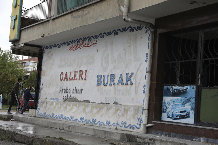 A Syrian car sellers with the original name changed from Arabic to Turkish after violent incidents in Altindag district in Ankara, Turkey, Wednesday, Sept. 15, 2021. Refugees fleeing the conflict in Syria once were welcomed in neighboring Turkey with open arms and compassion for fellow Muslims. But as their numbers swelled and Turkey became the host of one of the world's largest refugee populations in the world, attitudes gradually hardened. Anti-immigrant sentiment now is spilling over into open aggression and violence. (AP Photo/Burhan Ozbilici)