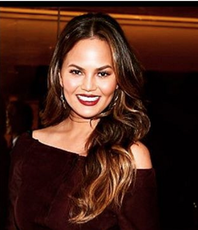 Chrissy Teigen looks like a tall glass of merlot in her wine-colored getup