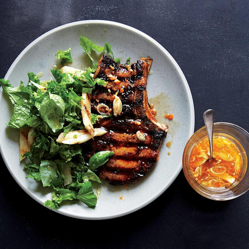 """This marinade packs sweet citrus flavor and extra spice into pork chops both before, and after, they hit the grill. <a href=""""https://www.epicurious.com/recipes/food/views/habanero-marinated-pork-chops-with-mustard-greens-slaw-56389713?mbid=synd_yahoo_rss"""" rel=""""nofollow noopener"""" target=""""_blank"""" data-ylk=""""slk:See recipe."""" class=""""link rapid-noclick-resp"""">See recipe.</a>"""
