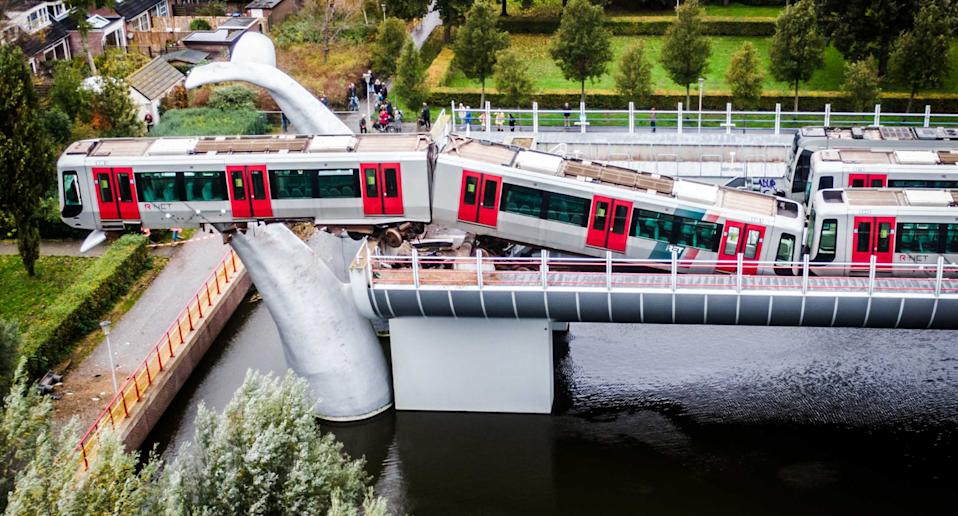 An overhead shot of the metro train that derailed onto a whale tail in the Netherlands.