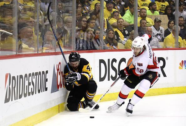 """PITTSBURGH, PA – MAY 15: <a class=""""link rapid-noclick-resp"""" href=""""/nhl/players/5714/"""" data-ylk=""""slk:Justin Schultz"""">Justin Schultz</a> #4 of the <a class=""""link rapid-noclick-resp"""" href=""""/nhl/teams/pit/"""" data-ylk=""""slk:Pittsburgh Penguins"""">Pittsburgh Penguins</a> kneels on the ice in pain after being checked by <a class=""""link rapid-noclick-resp"""" href=""""/nhl/players/4805/"""" data-ylk=""""slk:Mike Hoffman"""">Mike Hoffman</a> #68 of the <a class=""""link rapid-noclick-resp"""" href=""""/nhl/teams/ott/"""" data-ylk=""""slk:Ottawa Senators"""">Ottawa Senators</a> during the first period in Game Two of the Eastern Conference Final during the 2017 NHL Stanley Cup Playoffs at PPG PAINTS Arena on May 15, 2017 in Pittsburgh, Pennsylvania. (Photo by Bruce Bennett/Getty Images)"""