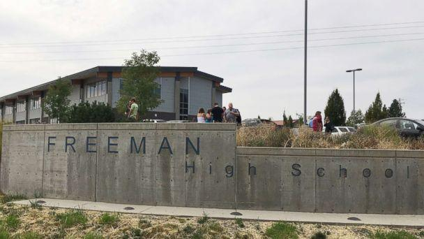PHOTO: People gather outside Freeman High School after reports of a shooting at the school in Rockford, Wash., on Sept. 13, 2017. (KHQ via AP)