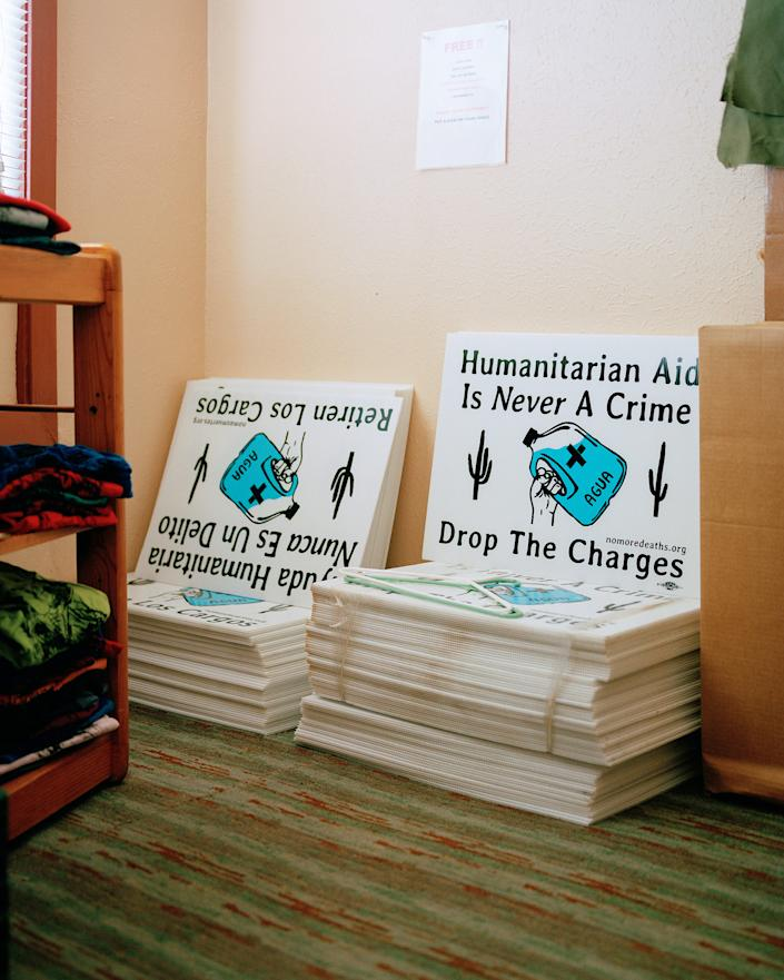 Signs in support of Warren that are available for businesses and homes sit in the Ajo Humanitarian Aid Office on Sept. 17.   Cassidy Araiza for TIME