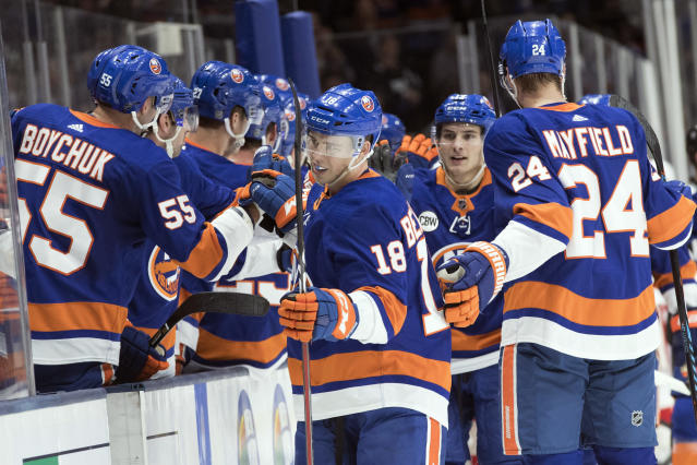 New York Islanders left wing Anthony Beauvillier (18) celebrates after scoring a goal during the first period of an NHL hockey game against the Detroit Red Wings, Saturday, Dec. 15, 2018, in Uniondale, N.Y. (AP Photo/Mary Altaffer)