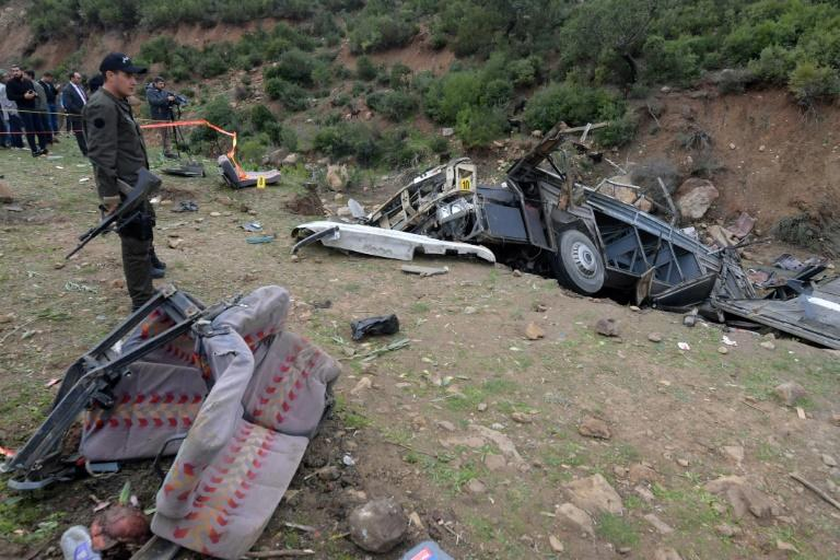 Tunisian security forces check the remains of a bus that plunged over a cliff into a ravine, in Ain Snoussi in northern Tunisia on December 1, 2019 killing 24 people (AFP Photo/Fethi Belaid)