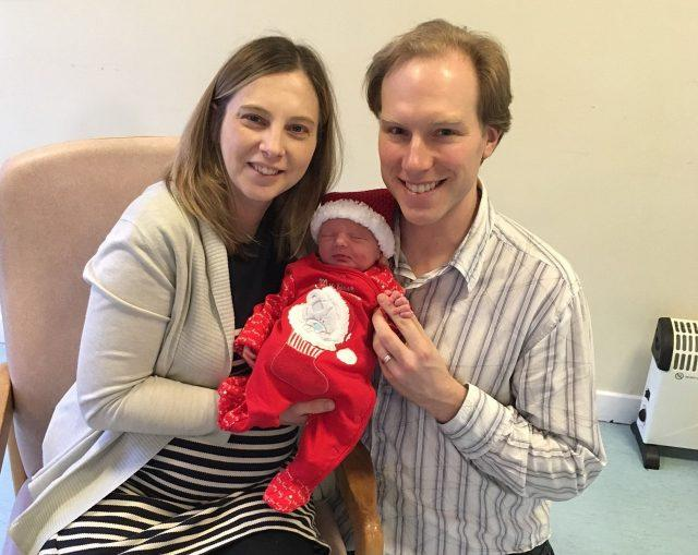 Karen and Michael Ratcliffe with their new baby who was born just moments into Christmas Day at Queen Elizabeth University Hospital, Glasgow (Family handout/PA)