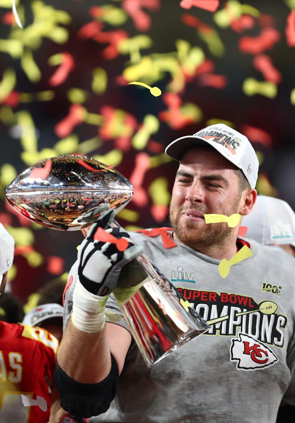 Feb 2, 2020; Miami Gardens, Florida, USA; Kansas City Chiefs tackle Eric Fisher (72) celebrates with the Vince Lombardi Trophy after defeating the San Francisco 49ers in Super Bowl LIV at Hard Rock Stadium. Mandatory Credit: Mark J. Rebilas-USA TODAY Sports