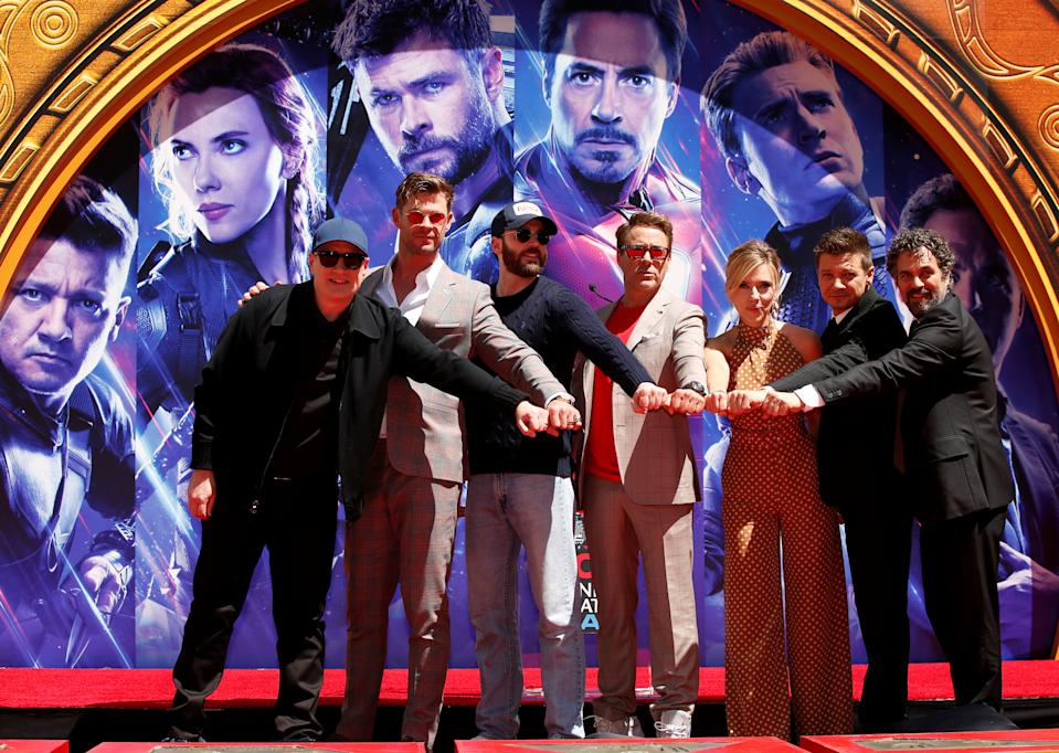 Actors Robert Downey Jr., Chris Evans, Mark Ruffalo, Chris Hemsworth, Scarlett Johansson, Jeremy Renner and Marvel Studios President Kevin Feige pose for a photo during the handprint ceremony at the TCL Chinese Theatre in Hollywood, Los Angeles, California, U.S. April 23, 2019. REUTERS/Mario Anzuoni