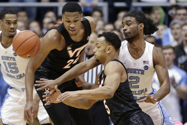 North Carolina's Coby White (2) chases the ball with Virginia Tech's Kerry Blackshear Jr. (24) and Justin Robinson (5) during the first half of an NCAA college basketball game in Chapel Hill, N.C., Monday, Jan. 21, 2019. (AP Photo/Gerry Broome)