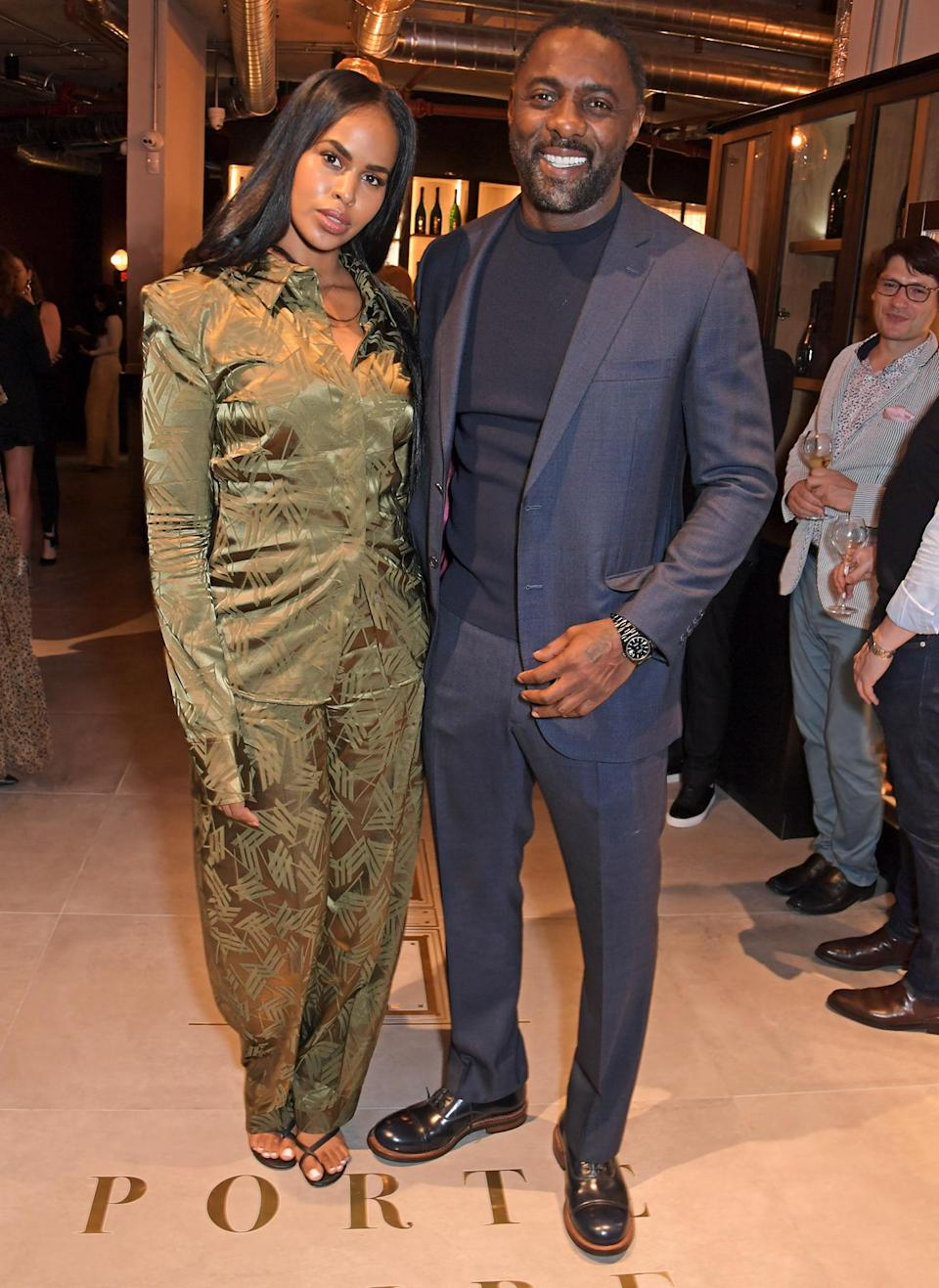 <p>Idris Elba and Sabrina Dhowre continue their stylish week out on Oct. 8 for the launch of the actor's new Port Noire Bar and Shop, in partnership with David Farber, in London's Coal Drops Yard.</p>