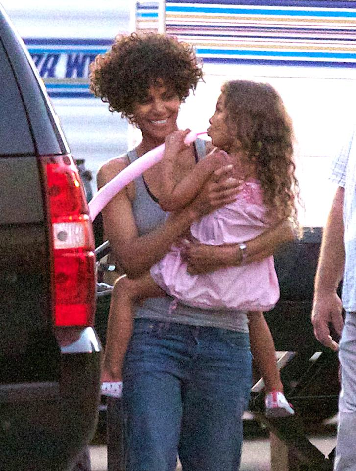 """Just two days after suffering a head injury on the set of her new film, """"The Hive,"""" Halle Berry returned to work toting along her 4-year-old daughter, Nahla. (7/19/2012)"""
