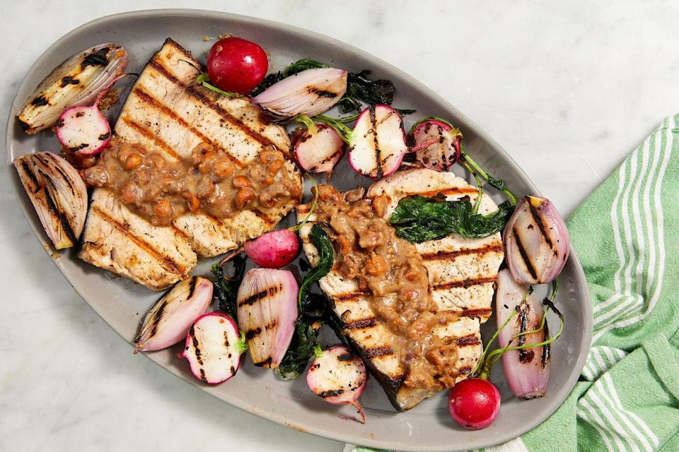 """<p>Swordfish is a sturdy meaty fish that won't flake out on the grill.<br></p><p>Get the recipe from <a href=""""https://www.delish.com/cooking/a36692726/grilled-swordfish-recipe/"""" rel=""""nofollow noopener"""" target=""""_blank"""" data-ylk=""""slk:Delish"""" class=""""link rapid-noclick-resp"""">Delish</a>.</p>"""
