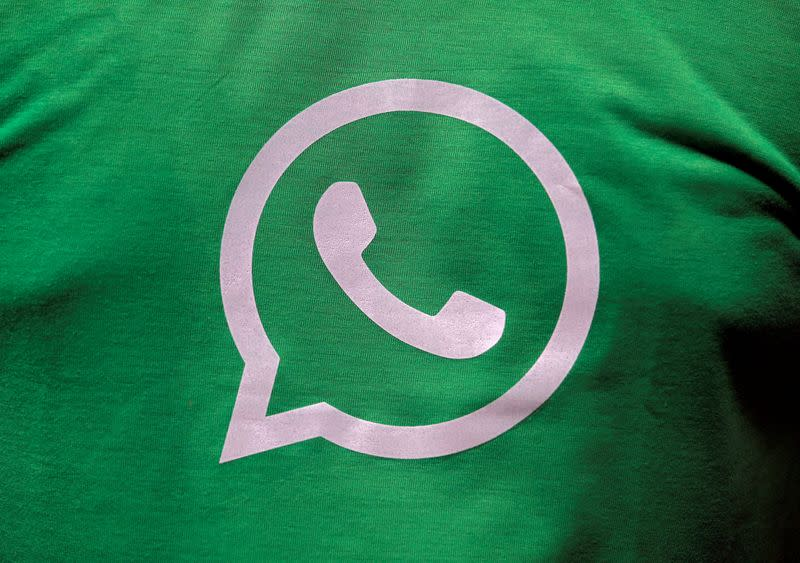 FILE PHOTO: FILE PHOTO: A logo of WhatsApp is pictured on a T-shirt worn by a WhatsApp-Reliance Jio representative during a drive by the two companies to educate users, on the outskirts of Kolkata