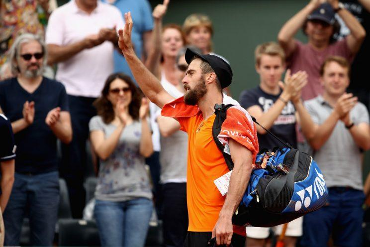 American tennis star waves to the crowd as he leaves the court at the end of his third-round French Open loss. (Getty Images)